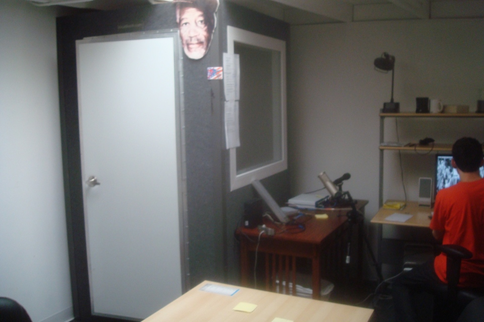 It may be small (and kind of smelly), but it does the trick. Morgan Freeman presides over our sound booth.  After all, he is the patron saint of voiceover.